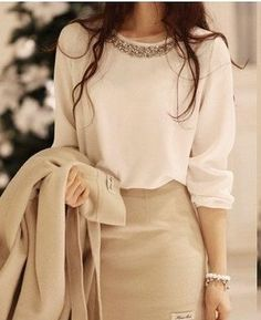 cream blouse with silver neckline, beige skirt and blazer