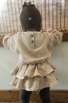 8bf08a2a40 Dress your baby girl in the sweetest muslin ruffle suit. Layer with a pair  of