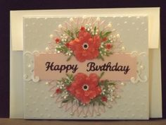 Floral birthday card in shades of pink.