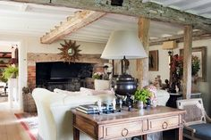 Escape to an exquisitely decorated Sussex farmhouse, a far cry from your typical country cottage. Tour more amazing real homes on HOUSE - design, food and travel by House & Garden.