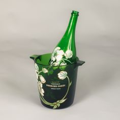 Vintage Perrier-Jouet Champagne Bottle and Bucket A decorative Champagne Bottle and Bucket advertising Perrier Jouet. Both pieces are made of etched glass with hand painted motifs. The bottle is dated from 1982.
