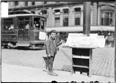 [Young newsboy standing next to a paper stand on a commercia Paper Stand, Commercial Street, Novels, Chicago, Museum, History, Books, Historia, Libros