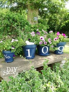 Paint each number on a different flower pot for a beautiful, blooming front yard display. Get the tutorial at The DIY Showoff.