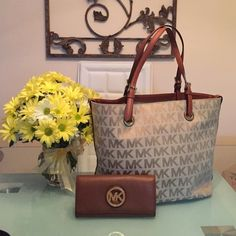 Beautiful Michael Kors handbag Perfect for fall Michael Kors tote only flaw ink inside price is only for bag the wallet has been sold! Michael Kors Bags Totes