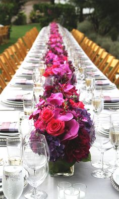 Gorgeous Fuchsia & purple long wedding reception tables on Lommel lawn at Calistoga Ranch. Fleurs de France www.fleursfrance.com