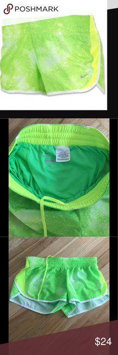 """Nike Dri-fit galaxy dash running shorts green 3"""" M Nike Dri-fit workout/running Shorts. Neon yellow and Green in color with the dash Galaxy print featuring the Nike swoosh on the bottom left of the front. Women's size Medium. Elastic waistband with drawstrings and built in underwear. 3"""" long. Interior pocket on the back. Excellent condition with no stains, rips or holes. Nike Shorts"""