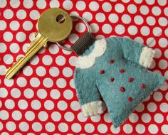 Keychain - blue coat with red buttons. $23.00, via Etsy.