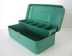 Vintage tackle box...I use mine for organizing my antique stand supplies and as a cash box while we're set up, but there are tons of uses! Makeup, crafts, sewing, gardening...