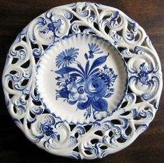 Charming hand painted pierced Italian made decorative plate. Made in Italy decorative plate Gorgeous blue rose and daisy design hand painted on white-white pierced plate.