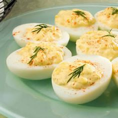Di's Delicious Deluxe Deviled Eggs    6	eggs  ½	stalk celery, finely chopped  ¼	onion, finely chopped  ¼	cup mayonnaise  salt to taste  1 dash hot pepper sauce  paprika, for garnish