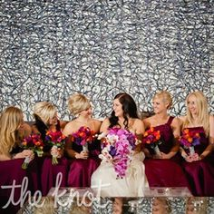 Each of Jessica's six bridesmaids chose her own dress style in the same rich sangria-purple color.