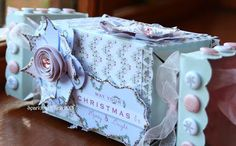 Craftwork Cards Blog: Christmas Crackers!  Cardstock white Christmas cracker decorated with patterned papers to take little gifts. Perfect to fill with Christmas chocolates and decorate table as name cards.