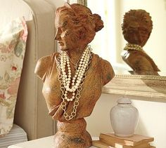 love the idea of using an old bust as a holder for long necklaces
