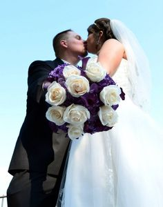 Wedding flowers - purple hydrangeas, purple calla lilies, and cream roses
