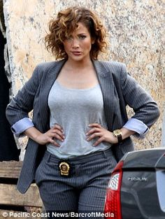 Lovin the hair!  Casual beauty: For the scene, Jennifer wore a loose T-shirt underneath a pin-striped suit...