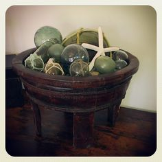 Glass buoys in antique Tibetan water bowl