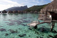 Overwater Bungalows in Moorea, French Polynesia.    Photo by Ncousla/Dreamstime.com