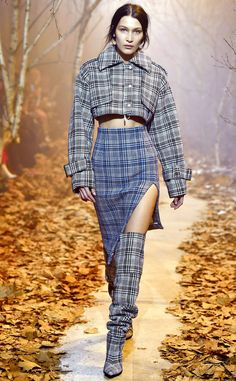 Bella Hadid from The Big Picture: Today's Hot Photos  Plaid party! The model works it onthe runway during the Off-White show during Paris Fashion Week.