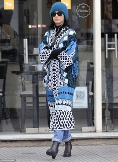 Stylish as ever: The 30-year-old dressed her svelte physique in a bold geometric print coa...