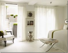 Clean yet comfy white bedroom