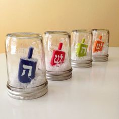 These dreidel snow globes will add color to your mantle. 22 Gorgeous Ways To Get Your Whole Family In The Hanukkah Spirit Hanukkah For Kids, Hanukkah Crafts, Jewish Crafts, Feliz Hanukkah, Hanukkah Decorations, Christmas Hanukkah, Happy Hanukkah, Hannukah, Holiday Crafts