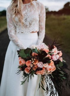 Lace two-piece bridal ensemble & lush bouquet of pink and coral | Image by Ash & Stone