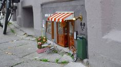 The anonymous artists, who go by the name 'Anonymouse', have created miniature but incredibly detailed scenes at street level— eye-level for mice. The tiny street art installations are located in Malmo, Sweden.
