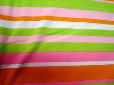 Orange, pink, and green jersey knit