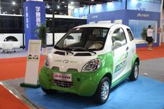 Kandi's electric car-sharing service hires out electric vehicles from vending-machine like buildings, proving profitable and moving into other Chinese cities.