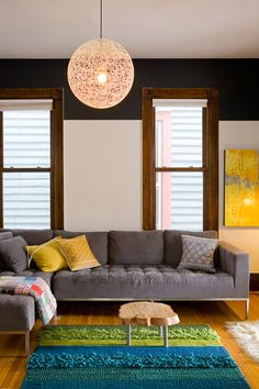 gray sectional; yellow pillows