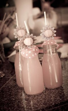 We served pink lemonade in recycled Starbucks bottles.  Over the mouth of jar were mini cupcake papers with a hole punched in them and then used flower straws I found at the dollar store. So cute!