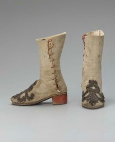 Pair of boots Italian, 1550–1650 Suede with metal embroidery on linen and appliquéd to leather, wood, cotton cord, brass tip, and leather Accession Number 43.1745a-b