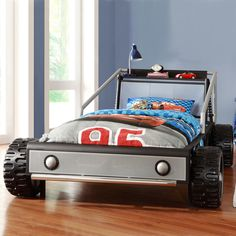 The Kiran RaceCar toddler bed is based on race car theme--your child will love getting into bed at night and racing off to dreamland. This twin-size frame makes transition from crib to bed easy with its fun design.