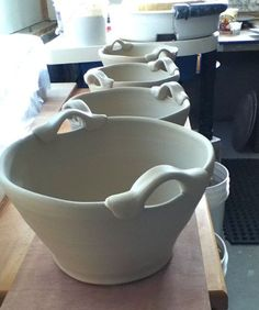 Becca's baskets...I love the handles! LOOK AT THE DRYING RACKS IN THE STUDIO