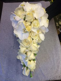 Shower bouquet of cream roses spray carnations and orchids no foliage with crystal and diamonds