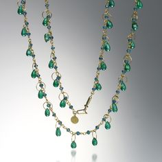 """@QUADRUM A Mallary Marks 18k and 22k yellow gold """"Spun Sugar"""" briolette necklace with 2mm apatite beads totaling 4.705cttw and cabochon bright green emerald briolettes totaling 12.036cttw. Total length measures  17.25"""" long."""