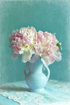 Peonies in light blue vase