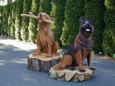 Man's Best Friends! Carved by ECHO Chainsaw Carving Team Member Bob King!