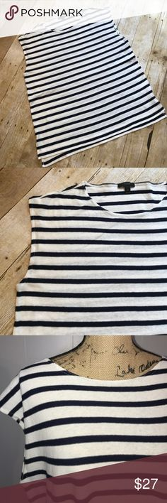 "J. Crew Navy and Cream Striped Tee NWOT J. Crew Navy and Cream Striped Tee. Boxy, oversized fit, split hem slightly longer in back. 100% cotton. Measures approximately 22"" across at bust, 26"" from shoulder to bottom of back hem. Size Medium. From a smoke free home. J. Crew Tops Tees - Short Sleeve"