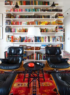 Eames lounge chairs and colorful bookshelf display
