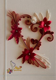 http://nelika-neli.blogspot.ca/2012/02/quilling-cards-with-love-2.html  Pinterest is not allowing me to upload images from her blog - ridiculous