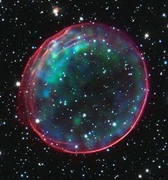A supernova remnant 170,000 light years away in one of the Milky Way's galactic neighbours. This image, taken by the Hubble Space Telescope, shows ambient gas being shocked by the expanding blast wave from the exploding star. Photograph: J Hughes (Rutgers University) and Hubble Heritage team/CXC/SAO/Nasa/ESA