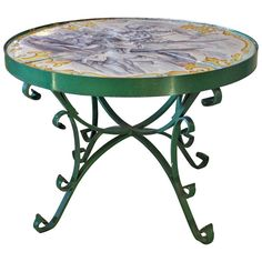 Italian Faience Tile Top Table with Iron Base | From a unique collection of antique and modern center tables at https://www.1stdibs.com/furniture/tables/center-tables/