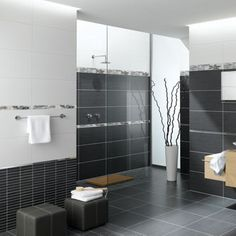 large format rectangular porcelain or ceramic tiles for the floor and walls? The larger size minimizes grout lines and definitely has a modern feel. Porcelain or ceramic are low maintenance (compared to natural stone)