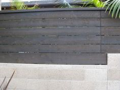 cement fence base with horizontal wood top