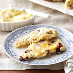 Cranberry Orange Scones Recipe -Moist and scrumptious, these scones come out perfect every time. I savor the chewy dried cranberries and sweet orange glaze. There's nothing better than serving these remarkable scones warm with the delicate orange butter. —Karen McBride, Indianapolis, Indiana