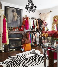 A spare bedroom turned dressing room -- more like a shop than a closet #chandelier #closet #dressing_room #eclectic #fireplace #zebra