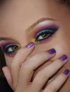 Check out my blog for more pictures of this look! http://mak3upstudio.wordpress.com/2012/07/08/bright-tropical-makeup/