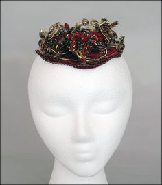 Bes-Ben 'Ruby jewel' hat   United States, ca. 1960   Small ruby velvet circular hat on which are mounted sprays of round and marquise shaped ruby colored stones set in gold wire