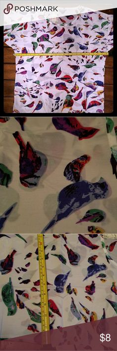 Livagirl blouse with birds Made in China. Their XXL = US Medium. Measures 21 across but there is no stretch. I wear an XL shirt with 36DD. no way this would fit me. Brand new with tags. Selling for what i paid  $4 + shipping. BEAUTUFUL bird print. Great for every day or events. Livagirl (China) Tops Blouses
